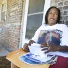 Sheila Osborn, Antwun Parker\'s aunt, looking through photos while on her sister\'s front porch talking about Parker in Oklahoma City Friday, May 29, 2009. Parker, 16, was killed by pharmacist Jerome Jay Ersland during an attempted robbery of Reliable Discount Pharmacy, 5900 S Pennsylvania Ave, on May 19, 2009.Photo by Paul B. Southerland, The Oklahoman
