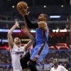 Oklahoma City\'s Russell Westbrook (0) goes to the basket between Los Angeles\' J.J. Redick (4) and Chris Paul (3) during Game 4 of the Western Conference semifinals in the NBA playoffs between the Oklahoma City Thunder and the Los Angeles Clippers at the Staples Center in Los Angeles, Sunday, May 11, 2014. Photo by Nate Billings, The Oklahoman