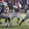 Oklahoma Sooners\' Roy Finch (22) runs between Kansas State Wildcats\' Tre Walker (50) and Arthur Brown (4) during the college football game between the University of Oklahoma Sooners (OU) and the Kansas State University Wildcats (KSU) at Bill Snyder Family Stadium on Sunday, Oct. 30, 2011. in Manhattan, Kan. Photo by Chris Landsberger, The Oklahoman ORG XMIT: KOD