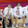 From left, Russia\'s Irina Osipova, Becky Hammon and Natalya Vieru sit on the bench during a women\'s basketball semifinal game at the 2012 Summer Olympics, Thursday, Aug. 9, 2012, in London. (AP Photo/Victor R. Caivano)