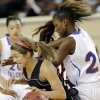 Verdigris\' Baileigh O\'Dell (25) drives past Millwood\'s Raven Prince (24) during the 3A girls quarterfinals game between Millwood High School and Verdigris High School at the State Fair Arena on Thursday, March 7, 2013, in Oklahoma City, Okla. Photo by Chris Landsberger, The Oklahoman