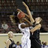 Verdigris\' Courtney Risenhoover (14) defends on Millwood\'s Raven Prince (24) during the 3A girls quarterfinals game between Millwood High School and Verdigris High School at the State Fair Arena on Thursday, March 7, 2013, in Oklahoma City, Okla. Photo by Chris Landsberger, The Oklahoman