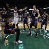 Photo - Atlanta Hawks' Cartier Martin, front left, tries to save the ball during the second half of an NBA basketball game against the Milwaukee Bucks, Wednesday, April 16, 2014, in Milwaukee. (AP Photo/Morry Gash)