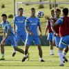 Photo - Japan's Keisuke Honda, center, watches a teammate throwing a ball during a training session of Japan in Itu  Brazil, Wednesday, June 11, 2014.  Japan play in group C of the 2014 soccer World Cup. (AP Photo/Shuji Kajiyama)