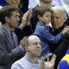 Vice President Joe Biden, right, holds his grandson Hunter next to his son, Beau, while watching a second-round game between Delaware and North Carolina in the women\'s NCAA college basketball tournament in Newark, Del., Tuesday, March 26, 2013. (AP Photo/Patrick Semansky)