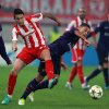 Olympiakos\' Leandro Greco, left, fights for the ball with Arsenal\'s Alex Oxlade-Chamberlain during a group B Champions League soccer match in the port of Piraeus, near Athens, Tuesday, Dec. 4, 2012. (AP Photo/Thanassis Stavrakis)