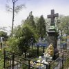 """In this picture taken May 10, 2013, a monument pays tribute to civilians who were burned alive during WWII in Pidhaitsi close to Ukraine\'s western city of Lutsk. The monument reads: """"To our parents, wives, children, who were murdered by the German occupants on December 3, 1943 in Pidhaitsi. 21 people, including 9 children."""" Evidence uncovered by AP indicates that Ukrainian Self Defense Legion commander Michael Karkoc\'s unit was in the area at the time of the massacre. (AP Photo/Efrem Lukatsky)"""