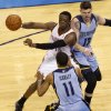 Oklahoma City\'s Reggie Jackson (15) passes the ball from between Memphis\' Mike Conley (11) and Mike Miller (13) during Game 5 in the first round of the NBA playoffs between the Oklahoma City Thunder and the Memphis Grizzlies at Chesapeake Energy Arena in Oklahoma City, Tuesday, April 29, 2014. Photo by Nate Billings, The Oklahoman