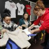 Students Hannah Scott (left) and Mikella Green, along with Freshman English teacher Natalie Zielny look through clothing donations at Westmoore High School in Moore, OK, Tuesday, Nov. 22, 2011. Westmoore High School is being creative in giving back with a program for giving clothes to students who can\'t afford them. By Paul Hellstern, The Oklahoman