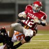 Carl Albert\'s Taylor Hawkins is brought down by Hollis Birmingham of Booker T. Washington during a high school football game in Midwest City, Okla., Friday, September 3, 2010. Photo by Bryan Terry, The Oklahoman