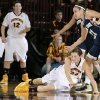 Central Michigan\'s Niki DiGuilio (24) crashes to the floor after losing the ball under pressure from Notre Dame\'s Kayla McBride (21) during the second half of an NCAA college basketball game on Thursday, Nov. 29, 2012, in Mount Pleasant, Mich. Notre Dame won 72-63. (AP Photo/Al Goldis)