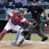 Photo - Seattle Mariners' Dustin Ackley (13) slides into home to score as Texas Rangers catcher Robinson Chirinos, left, reaches for the ball during the second inning of a baseball game on Wednesday, April 16, 2014, in Arlington, Texas. (AP Photo/Brandon Wade)
