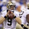 Photo - New Orleans Saints quarterback Drew Brees looks to throw against the Indianapolis Colts during the first half of an NFL preseason football game in Indianapolis, Saturday, Aug. 23, 2014. (AP Photo/Michael Conroy)