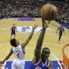 Photo - New York Knicks' Amar'e Stoudemire, right, goes up for a shot past Philadelphia 76ers' Nick Young during the first half of an NBA basketball game on Saturday, Jan. 26, 2013, in Philadelphia. (AP Photo/Matt Slocum)