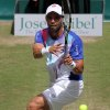 Photo - Colombia's Alejandro Falla returns the ball against Germany's Peter Gojowczyk quarterfinal match at the Gerry Weber Open tennis tournament in  Halle, Germany, Friday, June 13, 2014. Falla won the match with 7-6 and 7-6. (AP Photo/dpa, Oliver Krato)
