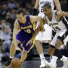 Los Angeles Lakers\' Steve Nash, left, and San Antonio Spurs\' Gary Neal (14) chase a loose ball during the second quarter of an NBA basketball game on Wednesday, Jan. 9, 2013, in San Antonio. (AP Photo/Eric Gay)