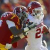 Oklahoma\'s Brennan Clay (24) fights off Iowa State\'s Cliff Stokes (7) during a college football game between the University of Oklahoma (OU) and Iowa State University (ISU) at Jack Trice Stadium in Ames, Iowa, Saturday, Nov. 3, 2012. Oklahoma won 35-20. Photo by Bryan Terry, The Oklahoman