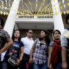 People emerge from a church as ashes on their forehead in the sign of a cross after a mass in observance of Ash AT a Catholic church in suburban Quezon City north of Manila, Philippines, Wednesday, Feb. 22, 2012. Ash Wednesday marks the beginning of Lent, a time when Christians prepare for Easter through acts of penitence and prayer(AP Photo/Pat Roque)
