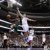 Milwaukee Bucks\' Brandon Jennings, left, goes up for a shot past Philadelphia 76ers\' Spencer Hawes (00) in the first half of an NBA basketball game, Monday, Nov. 12, 2012, in Philadelphia. (AP Photo/Matt Slocum)