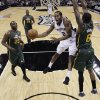 San Antonio Spurs\' Kawhi Leonard (2) drives to the basket as Utah Jazz\'s Josh Howard (8) and Al Jefferson (25) defend during the first quarter of Game 2 of a first-round NBA basketball playoff series, Wednesday, May 2, 2012, in San Antonio. (AP Photo/Eric Gay)