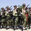 Photo - In this photo taken on March. 27, 2012, Myanmar soldiers march during a ceremony to mark the country's 67th Armed Forces Day in Naypyitaw, Myanmar. Ethnic Kachin rebels in Myanmar say clashes in the country's north are continuing despite a government promise to cease fire. An official with the Kachin Independence Army says government forces stopped attacks Saturday, Jan. 19, 2013 around an army base at Lajayang, just south of the rebel-held town of Laiza. But the official says army assaults are under way elsewhere on least three other rebel positions in the region. (AP Photo/Khin Maung Win)
