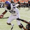 TCU\'s LaDarius Brown (85) breaks away from Oklahoma State\'s Kevin Peterson (1) on his way to a touchdown in the first quarter during a college football game between Oklahoma State University (OSU) and Texas Christian University (TCU) at Boone Pickens Stadium in Stillwater, Okla., Saturday, Oct. 27, 2012. Photo by Nate Billings, The Oklahoman