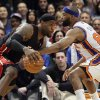 Photo -   Miami Heat's LeBron James drives past New York Knicks' Baron Davis during the first half of Game 4 of an NBA basketball first-round playoff series at Madison Square Garden, Sunday, May 6, 2012, in New York. (AP Photo/Frank Franklin II)
