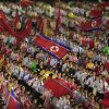 In this Monday, April 16, 2012 photo, students wave the national flags at an evening dancing party and performance at Kim Il Sung Square to commemorate late President Kim Il Sung\'s 100th birthday in Pyongyang, North Korea. AP photo Ng Han Guan