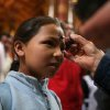 A catholic priest places ashes on the forehead of a faithful during an Ash Wednesday mass in Bogota, Wednesday, Feb. 25, 2009. Ash Wednesday marks the start of the Lent, the season of prayer and fasting before Easter. (AP/William Fernando Martinez)