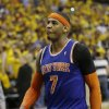 Photo - New York Knicks' Carmelo Anthony walks offcourt after the Indiana Pacers defeated New York 106-99 in Game 6 of an Eastern Conference semifinal NBA basketball playoff series on Saturday, May 18, 2013, in Indianapolis. Indiana won the series 4-2. (AP Photo/Darron Cummings)
