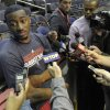 Photo - Washington Wizards point guard John Wall talks with the news media following a team practice at the Verizon Center in Washington, Monday, Dec. 17, 2012. Wall, the No. 1 overall pick in the 2010 draft, has been recovering from a stress injury to his left knee cap. AP Photo/Susan Walsh)