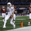 Texas A&M\'s Johnny Manziel (2) reaches the end zone for a touchdown as Oklahoma\'s Frank Shannon (20) and others give chase in the first half of the Cotton Bowl NCAA college football game Friday, Jan. 4, 2013, in Arlington, Texas. (AP Photo/LM Otero)