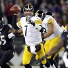 Photo - Pittsburgh Steelers quarterback Ben Roethlisberger (7) throws to a receiver in the first half of an NFL football game against the Baltimore Ravens, Thursday, Nov. 28, 2013, in Baltimore. (AP Photo/Nick Wass)