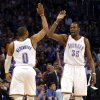 Oklahoma City \'s Kevin Durant (35) and Russell Westbrook (0) give each other a high five during the NBA game between the Oklahoma City Thunder and the Utah Jazz at the Chesapeake Energy Arena, Sunday, March 30, 2014, in Oklahoma City. Photo by Sarah Phipps, The Oklahoman