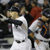 New York Yankees\' Raul Ibanez celebrates after hitting a two-run home run in the ninth inning of Game 1 of the American League championship series Saturday, Oct. 13, 2012, in New York. Detroit Tigers catcher Gerald Laird is at rear. (AP Photo/Paul Sancya )