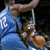 Oklahoma City\'s Kevin Durant runs into pressure from Orlando\'s Dwight Howard during the NBA basketball game between the Orlando Magic and the Oklahoma City Thunder at the Ford Center in Oklahoma City, on Sunday, Nov. 8, 2009. The Thunder beat the Magic 102-74. By John Clanton, The Oklahoman