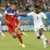 United States\' John Brooks, left, challenges Ghana\'s Asamoah Gyan for the ball during the group G World Cup soccer match between Ghana and the United States at the Arena das Dunas in Natal, Brazil, Monday, June 16, 2014. (AP Photo/Ricardo Mazalan)