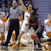 Photo - Florida guard January Miller (3) drives against Tennessee forward Cierra Burdick (11) in the first half of an NCAA college basketball game Thursday, Jan. 23, 2014, in Knoxville, Tenn. (AP Photo/Wade Payne)