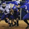 Hominy\'s Cody Pinkerton (4) looks to get past Dibble\'s Mike Coszalter (4) during the high school football playoff game between Dibble High School and Hominy High School at Dibble High School on Friday, Nov. 18, 2011. in Dibble, Okla. Photo by Chris Landsberger, The Oklahoman