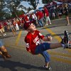 Logan Gauchat, 9, of Yukon, kicks the ball to a friend while tailgating before the college football game between the University of Oklahoma Sooners (OU) and the Tulsa University Hurricanes (TU) at the Gaylord Family-Memorial Stadium on Saturday, Sept. 3, 2011, in Norman, Okla. Photo by Chris Landsberger, The Oklahoman