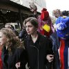 Photo - Pussy Riot members Nadezhda Tolokonnikova, center, and Maria Alekhina, left, arrive for a press conference while followed by a person in a chicken costume protesting the punk group - who have feuded with Vladmir Putin's government for years - Thursday, Feb. 20, 2014, in Sochi, Russia. (AP Photo/David Goldman)