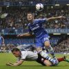 Chelsea\'s Gary Cahill, top, attempts to get the ball as Fulham\'s Scott Parker falls during the English Premier League soccer match between Chelsea and Fulham at Stamford Bridge, London, Saturday, Sept. 21, 2013. (AP Photo/Sang Tan)