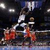Photo - Oklahoma City's Kendrick Perkins (5) dunks the ball during an NBA basketball game between the Oklahoma City Thunder and the Washington Wizards at Chesapeake Energy Arena in Oklahoma City, Wednesday, March 19, 2013. Photo by Bryan Terry, The Oklahoman