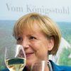 German Chancellor Angela Merkel, chairwoman of the Christian Democratic party CDU drinks a glass of withe wine at the party headquarters after the national elections in Berlin Sunday, Sept. 22, 2013. Chancellor Angela Merkel\'s conservatives triumphed in Germany\'s election Sunday, and could even win the first single party majority in more than 50 years. Her center-right coalition partners risked ejection from parliament for the first time in their post-World War II history.(AP Photo/dpa,Julian Stratenschulte)