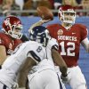 Oklahoma\'s Landry Jones (12) throws a pass during the Fiesta Bowl college football game between the University of Oklahoma Sooners and the University of Connecticut Huskies in Glendale, Ariz., at the University of Phoenix Stadium on Saturday, Jan. 1, 2011. Photo by Bryan Terry, The Oklahoman