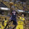 Photo - Atlanta Hawks' Jeff Teague shoots against Indiana Pacers' George Hill during the first half in Game 1 of an opening-round NBA basketball playoff series on Saturday, April 19, 2014, in Indianapolis. (AP Photo/Darron Cummings)