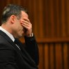 Photo - Oscar Pistorius listens to evidence in court in Pretoria, South Africa, June 30, 2014. The murder trial of Pistorius resumed Monday after one month during which mental health experts evaluated the athlete to determine if he has an anxiety disorder that could have influenced his actions on the night he killed girlfriend Reeva Steenkamp. (AP Photo/Phill Magakoe, Pool)