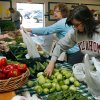 Sheila Savage (left) and Shannon Freeman buy vegetables at Oklahoma Botanicals booth at the Farmers Market at the Cleveland County Fairgrounds in Norman, Oklahoma on Saturday, April 19, 2008. BY STEVE SISNEY, THE OKLAHOMAN