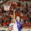 OSU\'s Keiton Page (12) is fouled by Brady Morningstar (12) of KU in the first half during the men\'s college basketball game between the University of Kansas (KU) and Oklahoma State University (OSU) at Gallagher-Iba Arena in Stillwater, Okla., Saturday, Feb. 27, 2010. Page made this basket and the foul shot. Photo by Nate Billings, The Oklahoman
