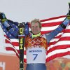 Men\'s giant slalom gold medalist Ted Ligety of the United States poses for photographers on the podium at the Sochi 2014 Winter Olympics, Wednesday, Feb. 19, 2014, in Krasnaya Polyana, Russia. (AP Photo/Christophe Ena)